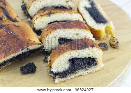 Homemade Poppy Seed Strudel Sliced On The Wooden Board