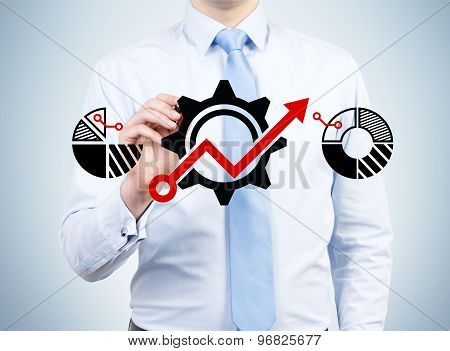 Businessman Is Drawing Gears With Red Drawing Arrow On The Glass Screen.