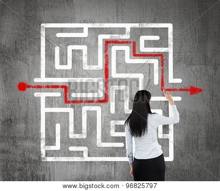 Brunette Business Woman Finding The Solution Of A Maze.