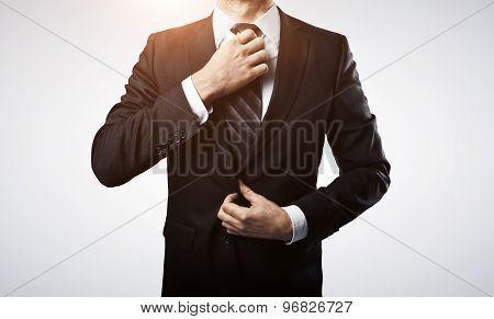 Businessman Adjusts His Tie