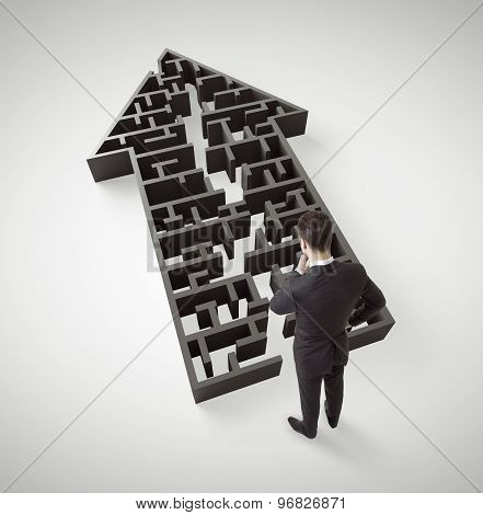 Businessman Standing In Arrow Form Maze