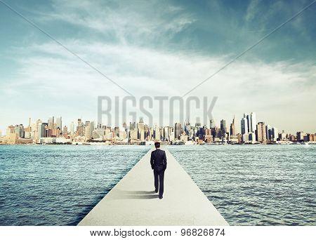Businessman In Suit Walking On Concrete Bridg