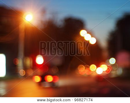 Defocused Lights From The Headlights And Tail Lights Of Cars