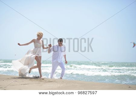 Laughing Wedding Couple On Beach