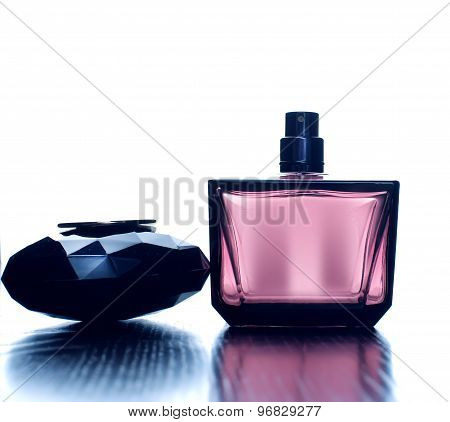 Pink Female  Perfume On A White Background