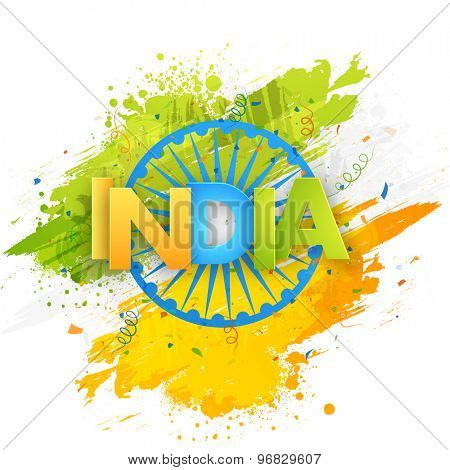 Shiny tricolor text India on Ashoka Wheel and national flag color splash background for Indian Independence Day celebration.