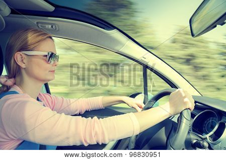 Pretty Woman In Sunglasses Driving Fast Car Filtered And Toned