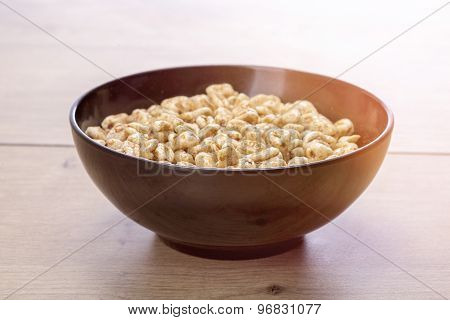 Black Bowl Of Cereals On A Wood Table