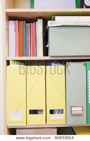 The image of folders on a shelf