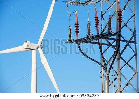 Windmill for electric power production and pylon, La Muela, Zaragoza Province, Aragon, Spain.