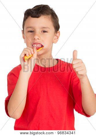 Young boy brushing his teeth signing OK
