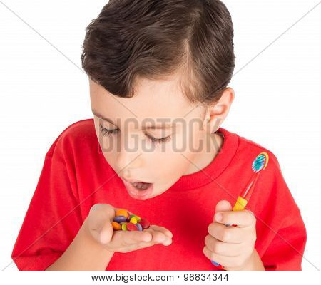 Young Boy With Candies And Teeth Brush