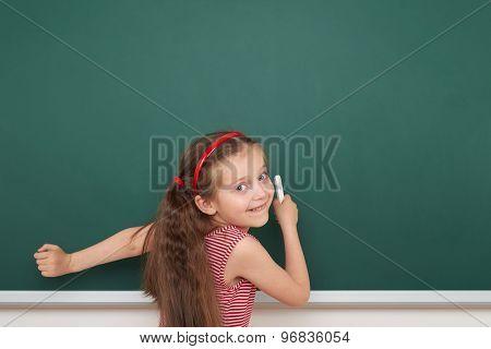 Schoolgirl write on the school board