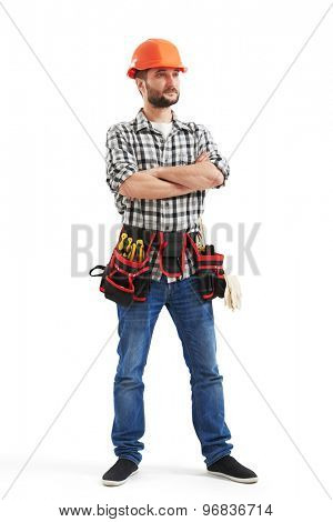 full-length portrait of serious workman with tools in orange helmet. isolated on white background