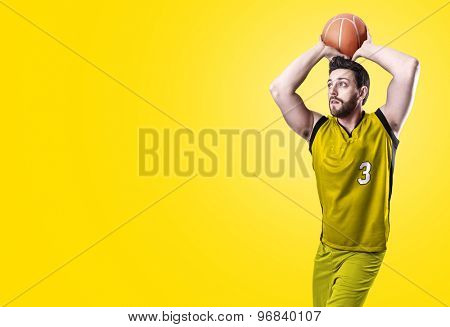 Basketball Player on a yellow uniform on yellow background