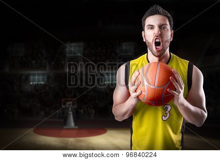 Basketball Player on a yellow uniform in basketball court