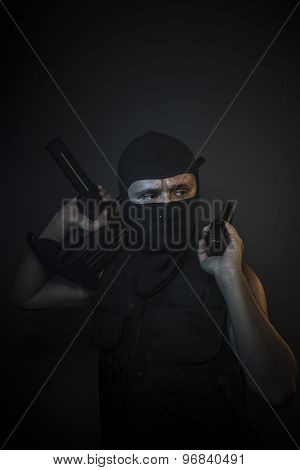 Gangster, Man wearing balaclavas and bulletproof vest with firearms