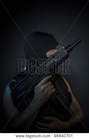 Criminal, Man wearing balaclavas and bulletproof vest with firearms