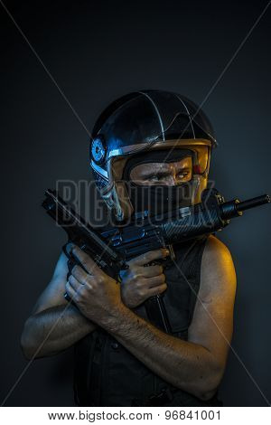 Weapon, murderer with motorcycle helmet and guns