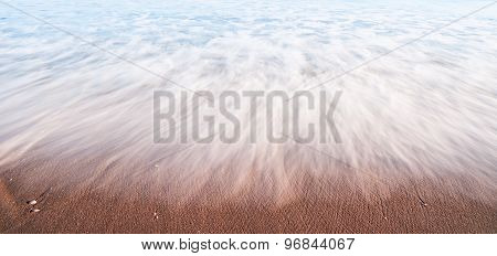 Water Washed Like Mist Over Sand.