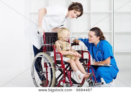 nurse and doctor chatting to girl