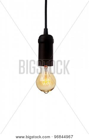 Glowing vintage light bulb isolated on white