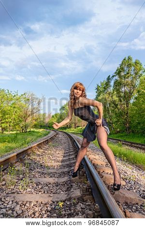 attractive girl hitchhiking on rail