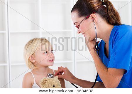 little girl having checkup