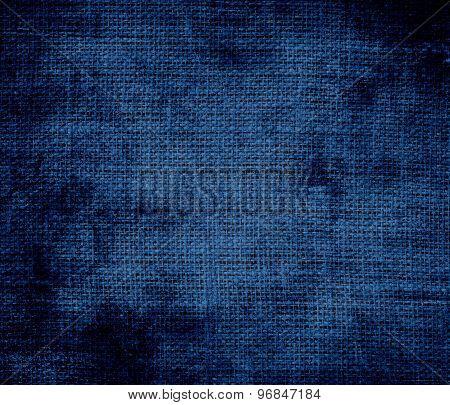 Grunge background of dark midnight blue burlap texture