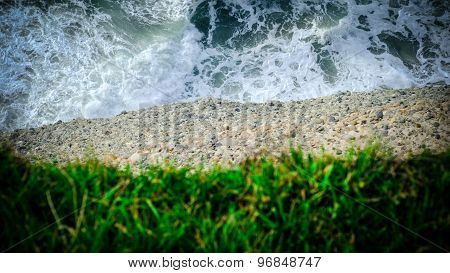 Water, Earth And Grass. Closeup Of A Cliff