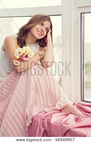 Romantic Girl Sitting By The Window