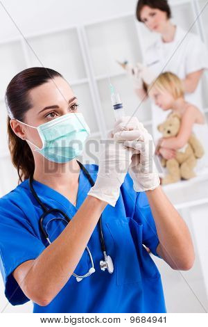 nurse giving child injection
