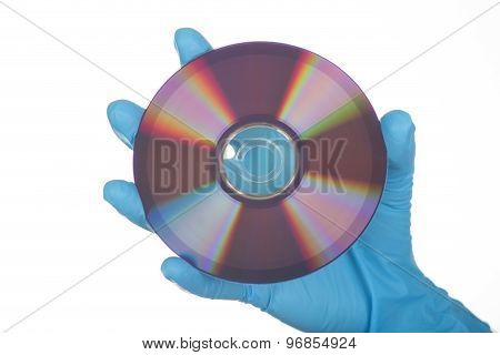 Female Hand In Glove With Dvd