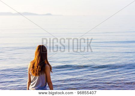 Beautiful Girl With Sunlight Travel And Vacation On The Beach Enjoying