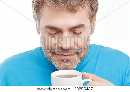 Pleasant man drinking tea