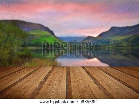 Llyn Nantlle At Sunrise Looking Towards Mist Shrouded Mount Snowdon With Wooden Planks Floor
