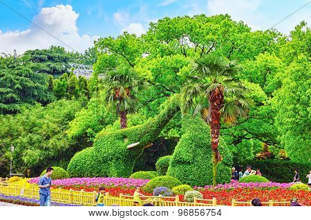 Beijing, China - May 24, 2015:floral - Leafy Composition Of Two Elephants Standing In The Beijing Zo