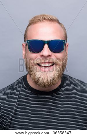 Smiling bearded man in sunglasses