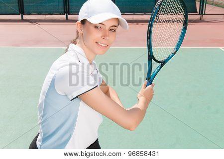 Nice girl playing tennis