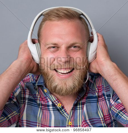 Bearded man in earphones