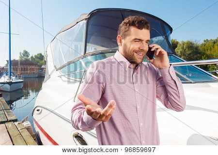 Pleasant man holding mobile phone