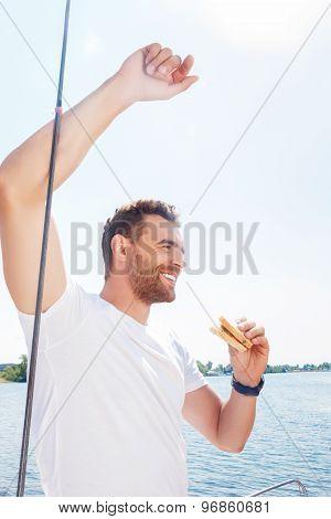 Vivacious man eating sandwich
