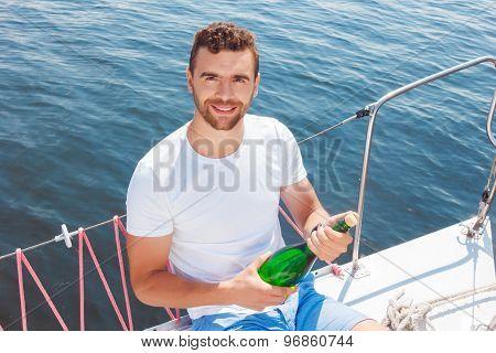 Upbeat man opening bottle