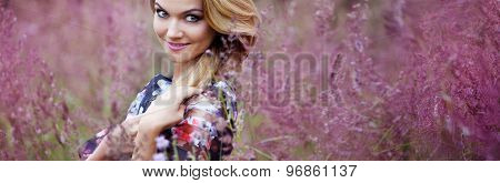 Blond girl in dress  on a meadow. Concept, horizontal format for web design