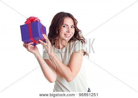 Smiling nice girl holding present
