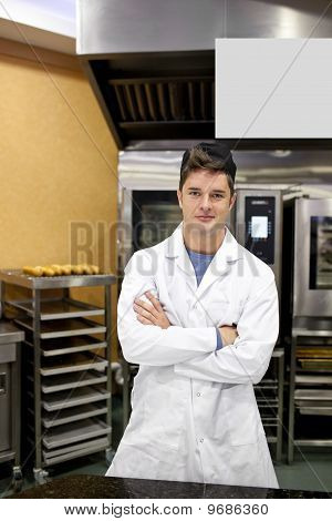 Proud Baker Standing In His Kitchen Bending His Arms Waiting For His Baguettes