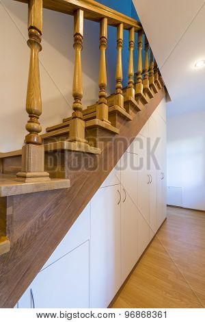 The staircase in the house with carved wooden railings