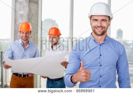 Successful young engineer is showing his positive emotions