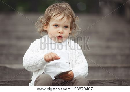 Little girl playing with mobile phone
