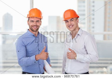 Cheerful young construction team are expressing happiness